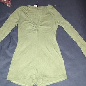 Green strapped body suit